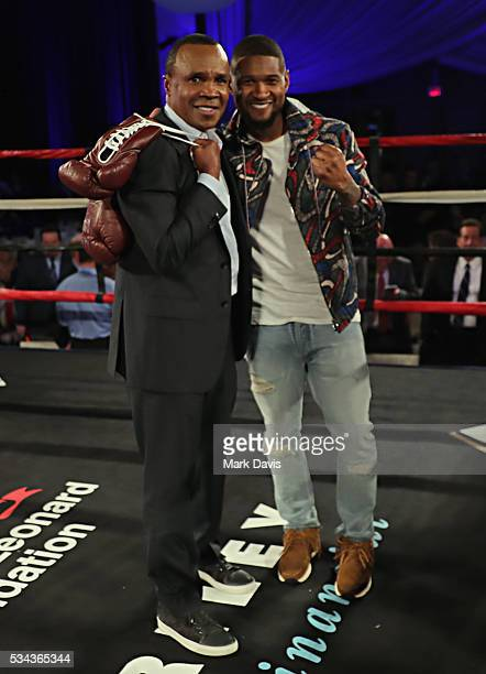 Sugar Ray Leonard and Usher attend B Riley Co and Sugar Ray Leonard Foundation's 7th Annual 'Big Fighters Big Cause' Charity Boxing Night at Dolby...