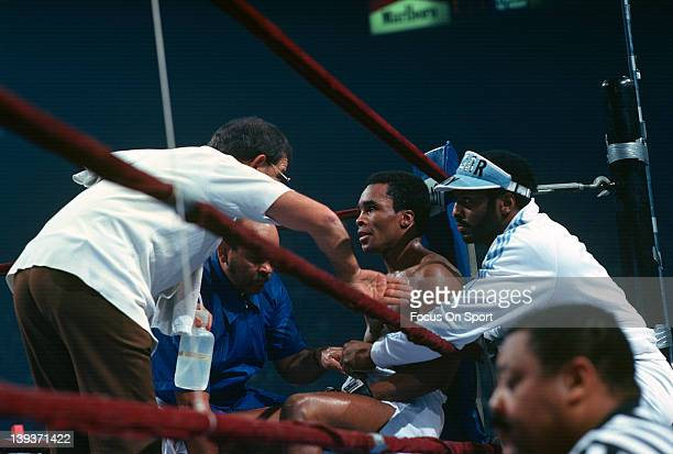 Sugar Ray Leonard center in his corner is attended to by trainer Angelo Dundee left during a scheduled twelve round WBC welterweight fight against...
