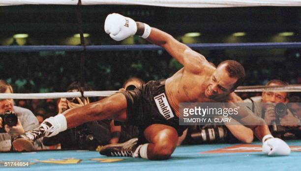 Sugar Ray Leonard goes down to the mat in the 1st round of his twelve round IBC Middleweight title fight against Hector Camacho 01 March at the...