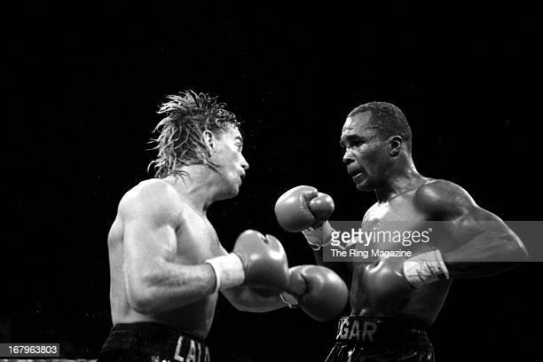 Sugar Ray Leonard looks to land a right punch to Donny Lalonde during the fight at Caesars Palace on November 11, 1988 in Las Vegas, Nevada. Sugar...