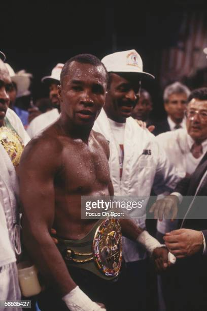 Sugar Ray Leonard wears his championship belt after defeating Donnie Lalonde circa 1988 during a boxing match.