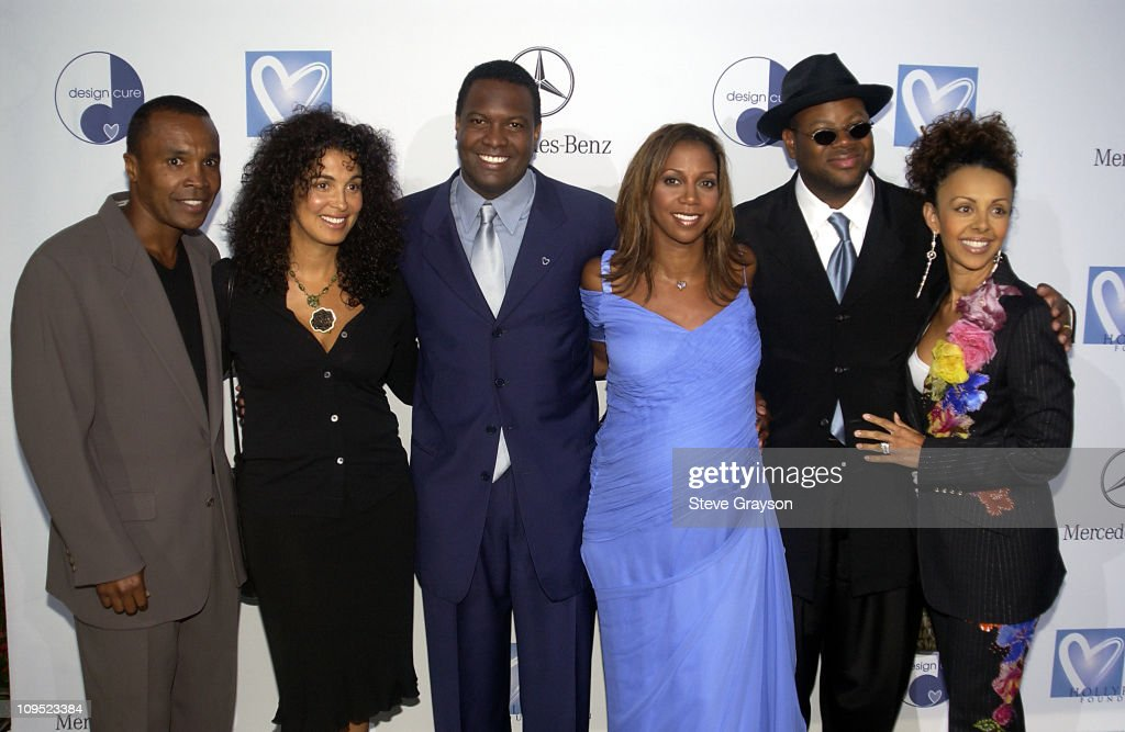 Holly Robinson Peete & Rodney Peete and Mercedes Benz Honor Muhammad Ali With The Designcure  Award of Courage