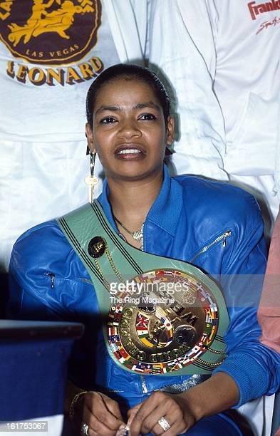 Sugar Ray Leonard's wife Juanita Wilkinson wears his championship belt during a press conference after the fight against Marvin Hagler at Caesars...