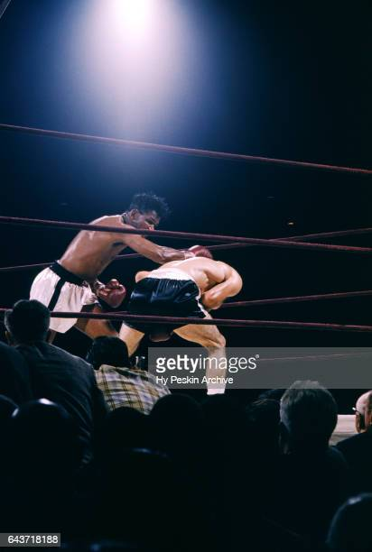 Sugar Ray Robinson lands a punch on Carmen Basilio during the World Middleweight Title Fight on September 23 1957 at Yankee Stadium in the Bronx New...