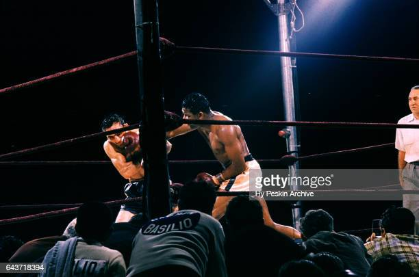 Sugar Ray Robinson of the United States lands a punch on Carmen Basilio of the United States during the 1957 World Middleweight Title bout on...