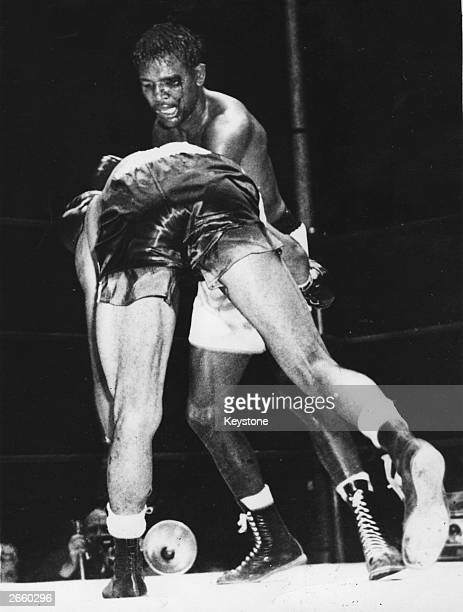 Sugar Ray Robinson on his way to beating Randolph Turpin during their world middleweight title fight at the Polo Grounds New York
