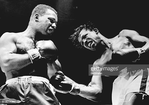 Sugar Ray Robinson, , swings viciously at Ralph Jones--but misses in the fourth period of their ten stanza middleweight scrap at Chicago Stadium....