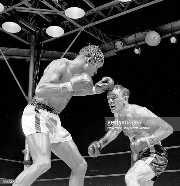 Sugar Ray Robinson trying to keep Carmen Basilio at bay during their middleweight bout at Yankee Stadium Basilio won a 15round split decision