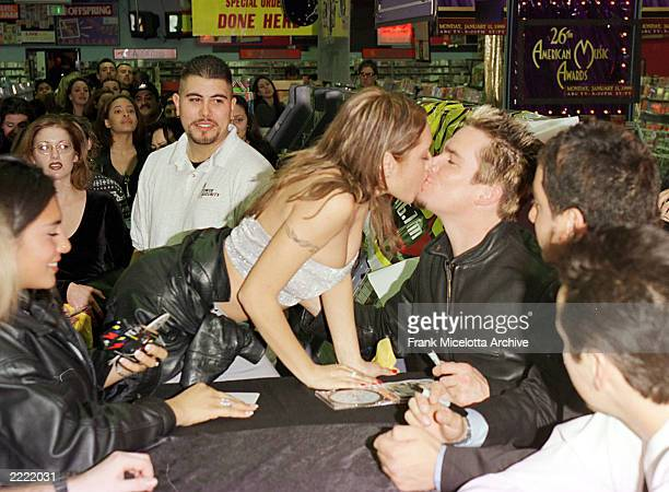 Sugar Ray singer Mark McGrath kisses a fan at the Tower Records store on Sunset Blvd in Hollywood California where the band signed copies of their...