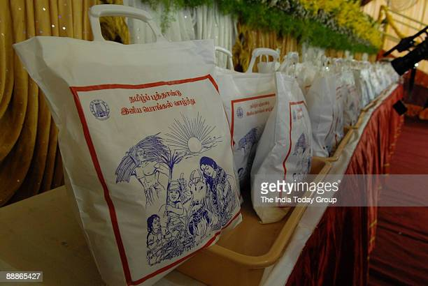 Sugar Rice Dhoti and Saree free distribution on Pongal by M Karunanidhi Chief Minister of Tamil Nadu in Chennai Tamil Nadu India