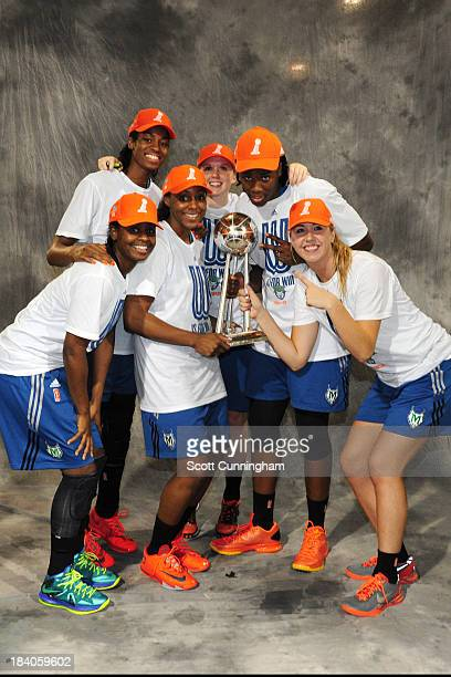 Sugar Rodgers Devereaux Peters Monica Wright Lindsey Moore Rachel Jarry and Amber Harris of the Minnesota Lynx poses for a picture with the trophy...
