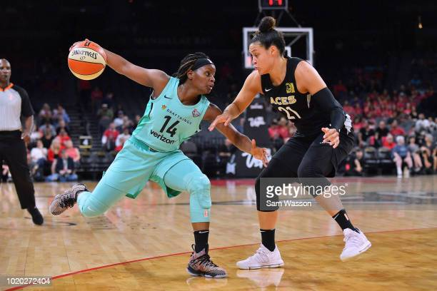 Sugar Rodgers of the New York Liberty dribbles against Kayla McBride of the Las Vegas Aces during their game at the Mandalay Bay Events Center on...