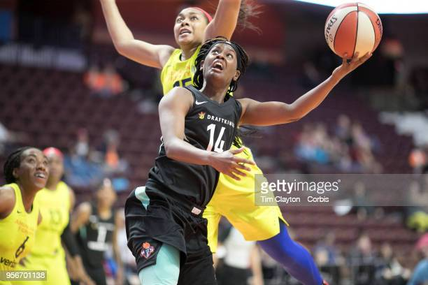 Sugar Rodgers of the New York Liberty dribves to the basket defended by Allisha Gray of the Dallas Wings during the Dallas Wings Vs New York Liberty...