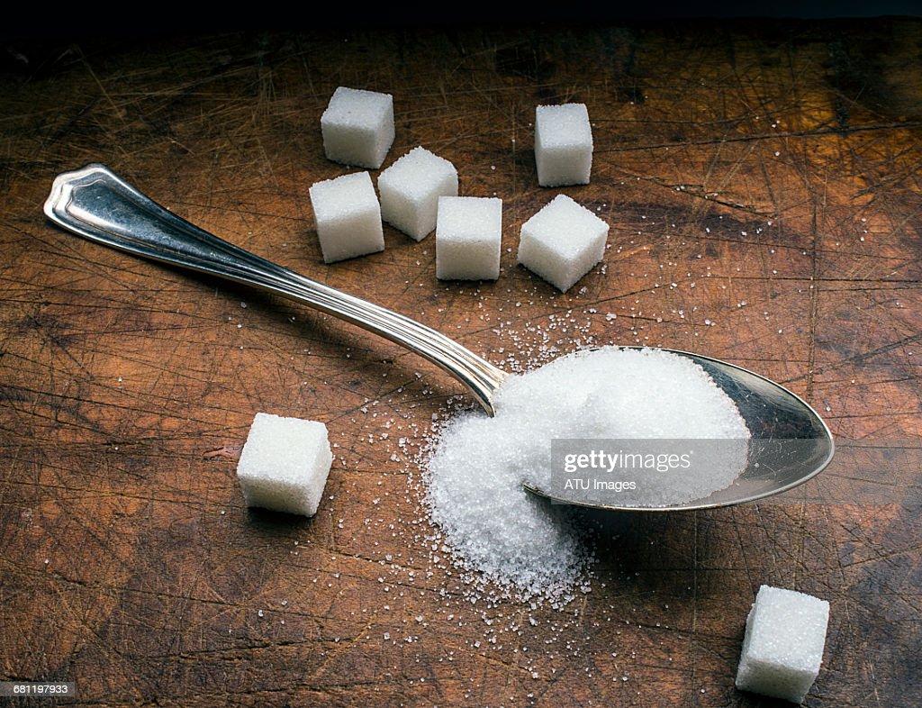 sugar spoon on wood : Stock Photo