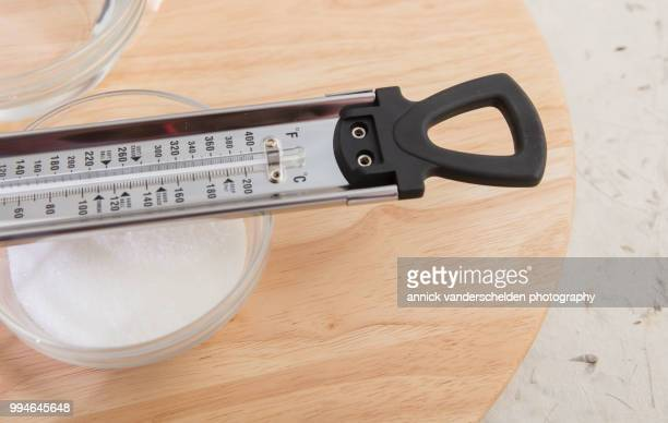 sugar thermometer, granulated sugar and water - celsius ストックフォトと画像