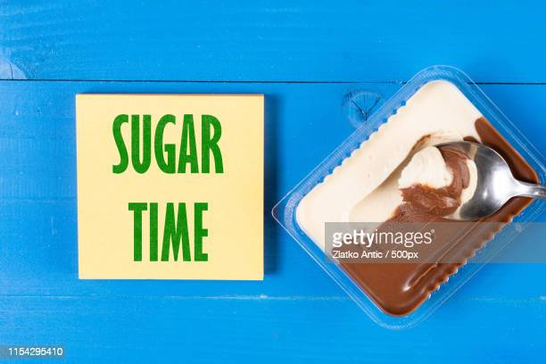 sugar time text concept with chocolate cream and spoon - theobroma imagens e fotografias de stock