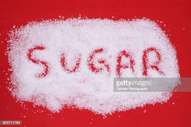 Sugar written in white sugar