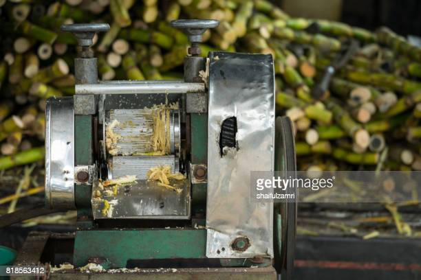 sugarcane juice machine at street of kota baharu, malaysia. its an extremely common street drink in asean. - shaifulzamri stock pictures, royalty-free photos & images