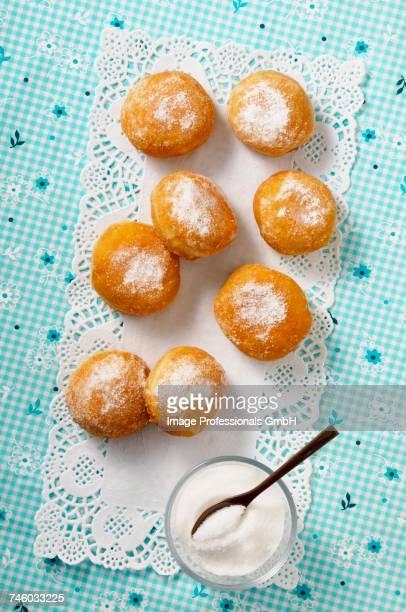 Sugared doughnuts on a doily