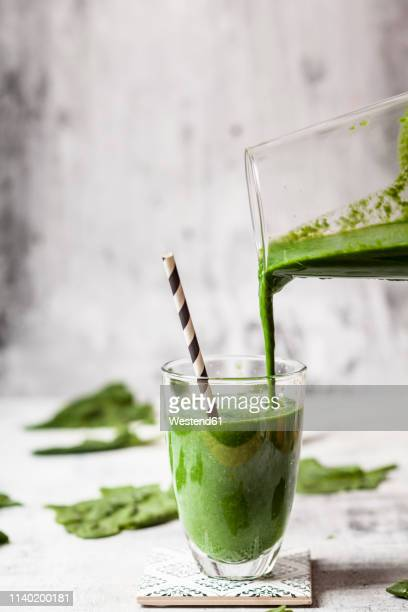 sugar-free, vegane detox smoothie with spinach, almond milk and banana - smoothie stock pictures, royalty-free photos & images