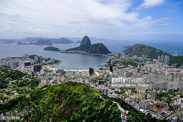 Sugarloaf Mountain And Cityscape By Sea Against Sky