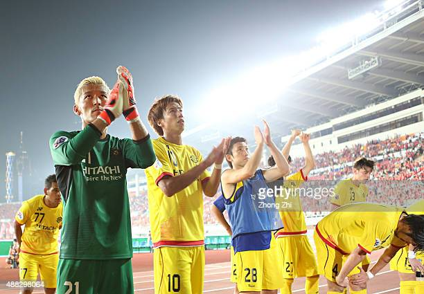Sugeno Takanori of Kashiwa Reysol and teammates react after losing the Asian Champions League Quarter Final match between Guangzhou Evergrande and...