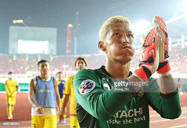Sugeno Takanori of Kashiwa Reysol reacts after losing the Asian Champions League Quarter Final match between Guangzhou Evergrande and Kashiwa Reysol...