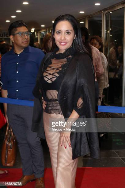 Sugey Abrego poses for photos on the red carpet during a new premiere of the play 'Suertudotas' after changing the venue to Teatro Insurgentes on...