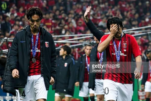 Sugimoto Kenyu and Koroki Shinzo of Urawa Red Diamonds show their dejection after the AFC Champions League Final second leg match between Urawa Red...