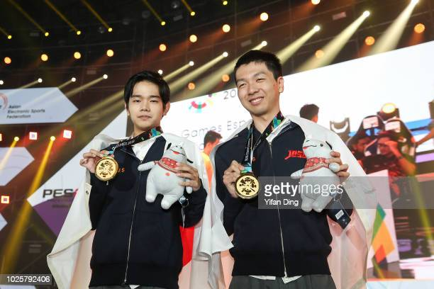 Sugimoto Naoki and Aihara Tsubasa of Japan pose for photo during Asian Games Esports Demonstration Event Pro Evolution Soccer medal ceremony at...