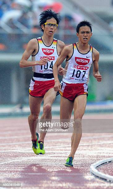 Suguru Osako and Yuki Sato compete in the Men's 10000m during day two of the 98th All Japan Track and Field Championships at Fukushima Azuma Stadium...