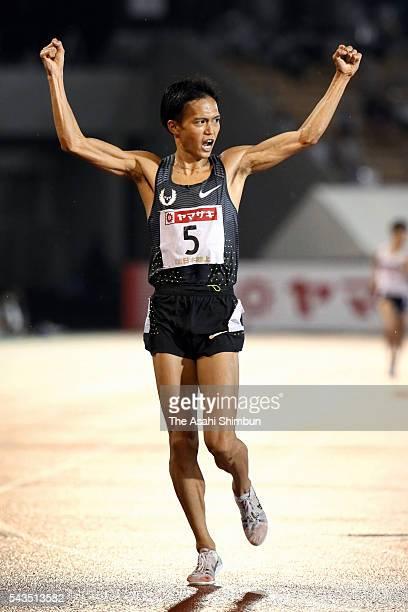 Suguru Osako celebrates winning the Men's 10000m during day one of the 100th Japan National Athletic Championships at the Paroma Mizuho Stadium on...