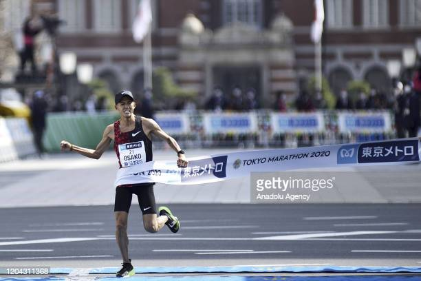 Suguru Osako expresses his joy as he crosses the finish line and wins the forth place of the Tokyo Marathon 2020 in Elite Men category breaking the...