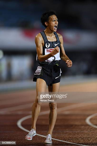 Suguru Osako of Japan celebrates after winning the competes in the Men's 10000m during the 100th Japan National Athletic Championships at the Mizuho...
