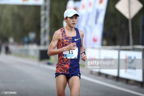 Suguru Osako of Japan finishes during the Honolulu Marathon 2019 on December 08 2019 in Honolulu Hawaii