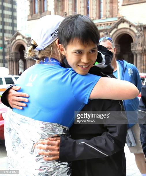 Suguru Osako of Japan is congratulated after finishing third in the men's race of the Boston Marathon in Massachusetts in his marathon debut on April...