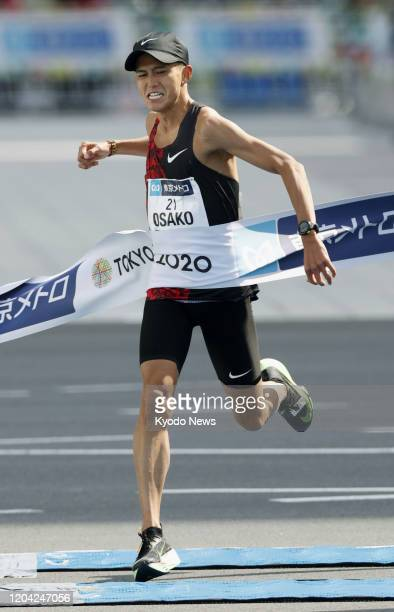 Suguru Osako of Japan pumps his fist as he finishes fourth and breaks his own national record at the Tokyo Marathon on March 1 to move closer to...