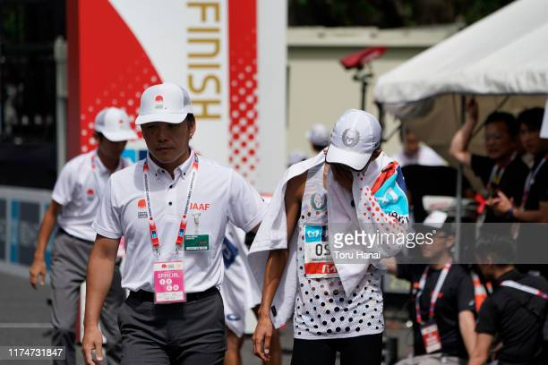 Suguru Osako of Japan reacts after crossing the finish line to take third place during the Marathon Grand Championships Tokyo 2020 Test Event on...