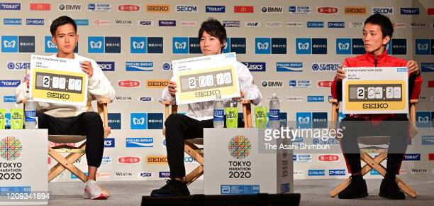 Suguru Osako, Yuta Shitara and Hiroto Inoue of Japan attend the Tokyo Marathon press conference on February 28, 2020 in Tokyo, Japan.