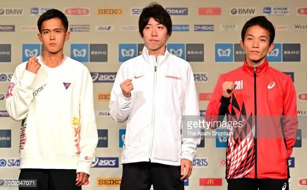 Suguru Osako, Yuta Shitara and Hiroto Inoue of Japan pose for photographs during the Tokyo Marathon press conference on February 28, 2020 in Tokyo,...