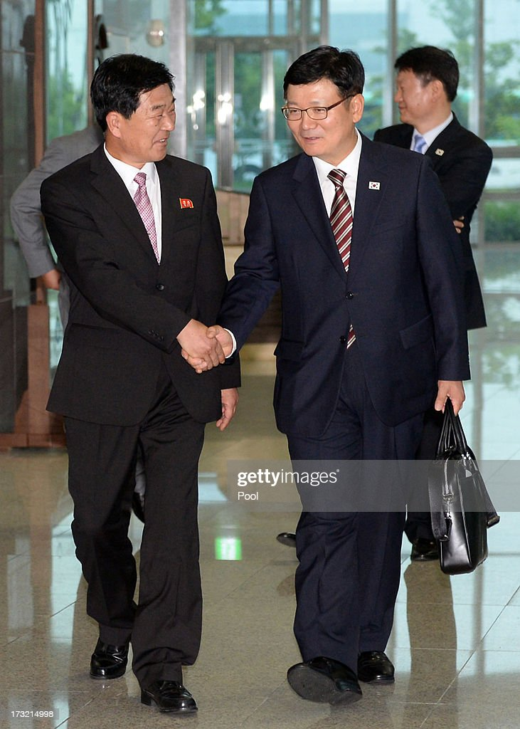 Suh Ho, the head of South Korea's working-level delegation (R) shakes hands with his North Korean counterpart Park Chol-Su (L) as they leave after meeting at Kaesong Industrial District Management Committee on July 10, 2013 in Kaesong, North Korea. Government officals and business leaders from North and South Korea will hold talks today to discuss resuming operations at the Kaesong Joint Industrial Park 10 kilometres north of the border. North Korea withdrew over 50,00 of it's staff from the factories owned by Seoul in April of this year, and South Korea removed managers in May, during the height of tensions between the two nations.