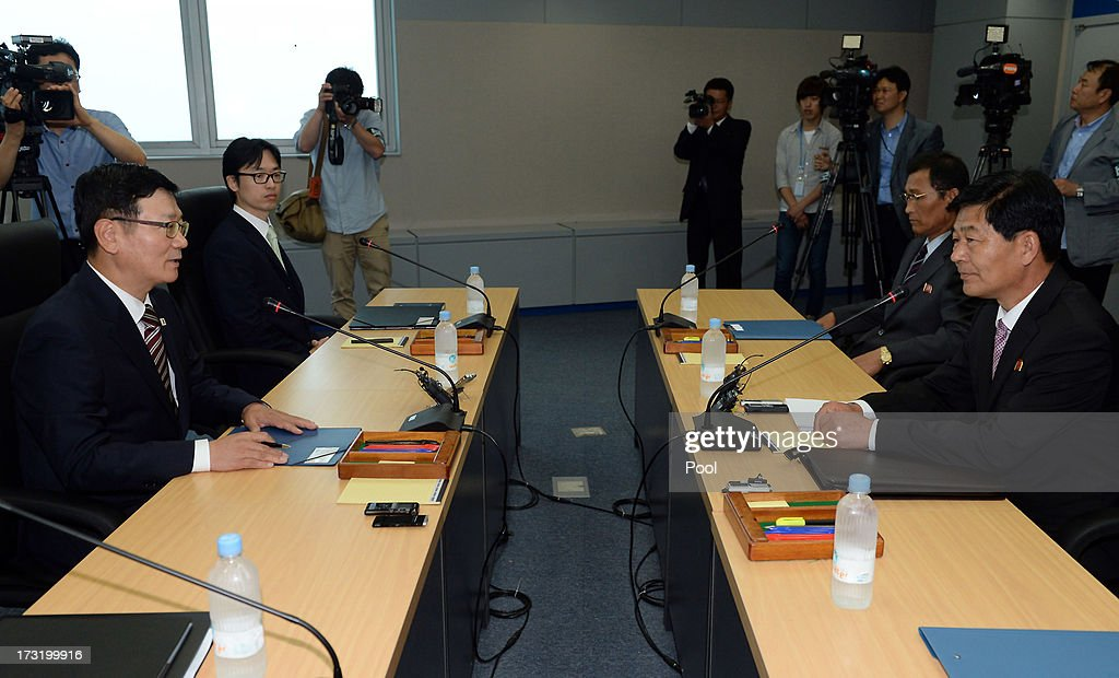 Suh Ho, the head of South Korea's working-level delegation (L) talks with his North Korean counterpart Park Chol-Su (R) during their meeting at Kaesong Industrial District Management Committee on July 10, 2013 in North Korea. Government officals and business leaders from North and South Korea will hold talks today to discuss resuming operations at the Kaesong Joint Industrial Park 10 kilometres north of the border. North Korea withdrew over 50,00 of it's staff from the factories owned by Seoul in April of this year, and South Korea removed managers in May, during the height of tensions between the two nations. (Photo by Jung Yeon-Ho-Korea Pool/Getty Images).