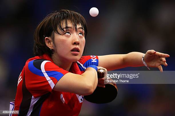 Suh Hyowon of South Korea serves in her Round of 16 Elimination Match against Ri Myongsun of North Korea during day thirteen of the 2014 Asian Games...
