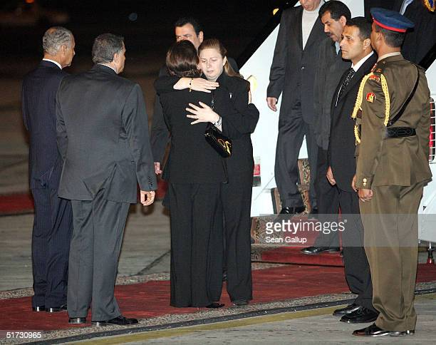 Suha Arafat widow of Palestinian President Yasser Arafat is greeted by Suzanne Mubarak wife of Egyptian President Hosni Mubarak upon her arrival with...