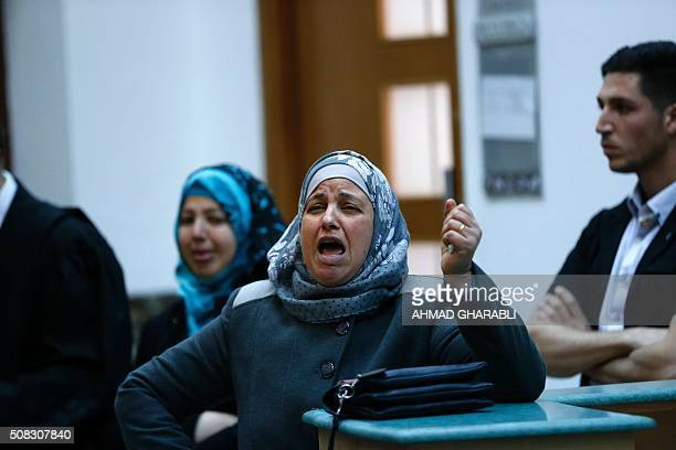 Suha the mother of Palestinian teenager Mohammed Abu Khdeir who was killed in 2014 cries in a courtroom after the sentences were announced on...