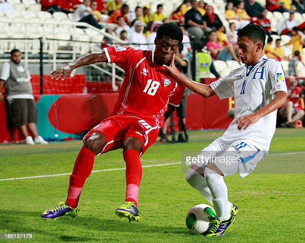 Suhail Al Noobi of the UAE vies for the ball against Christopher Alegria of Honduras during their FIFA U17 World Cup UAE 2013 football match at the...