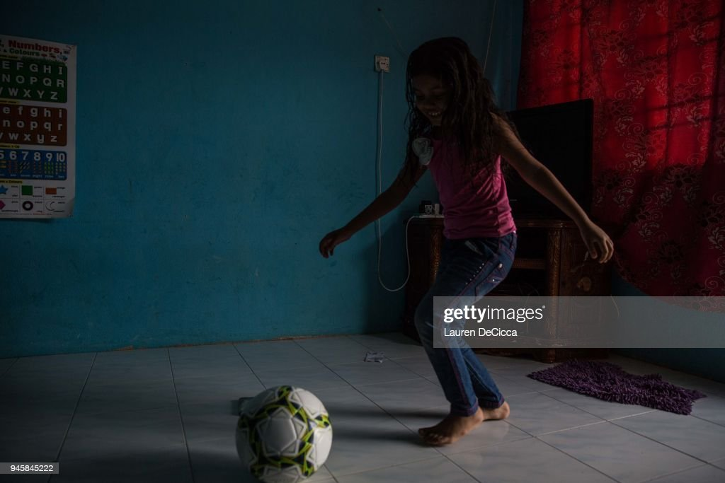Suhana, 6, plays football in her family's home on April 12, 2018 in Kulim, Malaysia. Suhana's father Mohammed Eoris plays for the Kedah Kulim Football Club and encourages his children to practice sports at home. Football has been a community building method for the Rohingya living in Malaysia, helping to bring people together and raise awareness for the Rohingya crisis throughout the region. A group of Rohingya refugees from Myanmar's Rakhine State formed the Rohingya Football Club in Malaysia back in 2015, hoping to give the Rohingya people a voice through sports and raise their international profile amidst the crisis in the region. Rohingya Muslims are reportedly playing in Football Clubs around the world, including Canada, Australia, and Ireland, while the Rohingya F.C. aims to set up a national team which comprises of these players and show that Rakhine Muslims can succeed in the sport. The United Nations estimate that over 62 thousand Rohingya are currently living in Malaysia and most of them are only able to find jobs as a construction worker or laborer with many staying in makeshift homes near construction sites. Malaysia launched its first Rohingya tournament this year with 24 independent football clubs competing across the Muslim country, hoping to gather support from the Malaysian and Turkish governments to help them succeed at an international level. Over 700,000 Muslim Rohingya have crossed the border into Bangladesh since August last year after the Myanmar military launched a brutal crackdown which was described by the United Nations as 'ethnic cleansing' while the two countries continue to negotiate the repatriation of the Rohingya refugees.