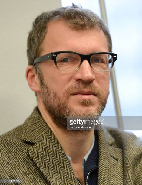 Suhrkamp author Andreas Maier is seen before the trial at the Regional Court in Frankfurt Main Germany 13 February 2013 The court adjourned the...