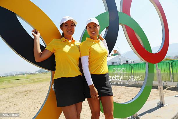 SuHyun Oh and Minjee Lee of Australia pose together during a practice round prior to the start of the women's golf during Day 10 of the Rio 2016...