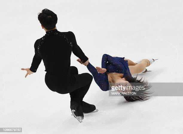 TOPSHOT Sui Wenjing and her partner Han Cong of China compete before winning the Pairs competition during the ISU Four Continents Figure Skating...